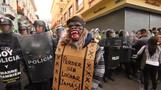 Tense clashes in Quito as riot police quell protest