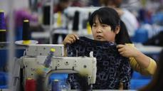 China factories chug along but employment still sluggish