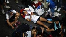 Behind the barricades, Hong Kong demonstrators dig in