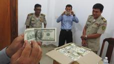Cambodian police rake in counterfeit cash haul