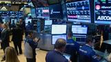 Stocks end mixed after wild ride