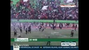 Soccer fans clash with Indonesian police