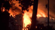 Firefighters battle massive warehouse fire