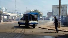 Togo police fire tear gas, water canon to break up opposition march