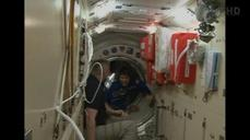 Multi-national crew safely docks at space station