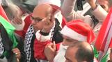 Palestinian protesters dressed as Santa clash with Israeli army
