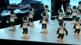 Robots dance in mass-games fashion