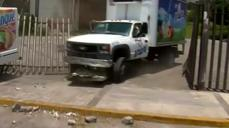 Mexican protesters hurl rocks, smash windows to mark students' d