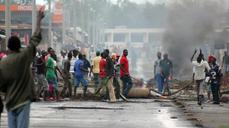 Despite violence, Burundi court says president can run ag