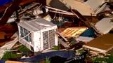 Severe storms kill two in Arkansas, shatter Texas town