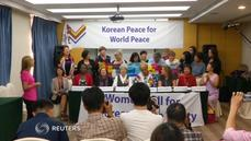 Female activists prepare to march for Korean reconciliation