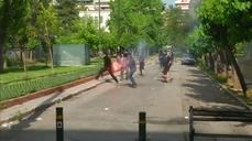 Protesters clash with police, torch bus in Athens