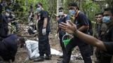Malaysia exhumes graves at trafficking camp