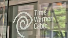 Charter buying larger rival Time Warner Cable