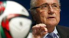 FIFA says Blatter to seek fifth term despite arrests