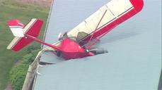 Man crashes small plane into barn