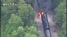 Freight train derails, catches fire
