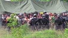 Police tear gas migrants at Hungary camp