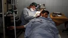 Afghan surgeon takes up scalpel for the poor