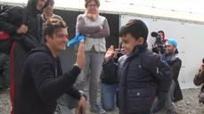 Orlando Bloom visits migrant camp
