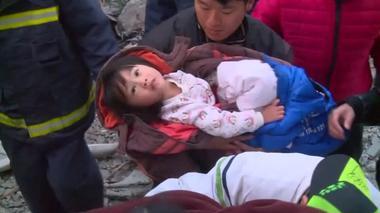 Rescuers pluck quake survivors from building