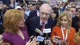 Media swarm Warren Buffett