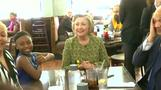 Clinton chats with young girl at Indiana diner