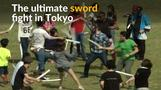 Foam swords drawn in mass play fight in Tokyo park