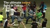 Foam swords drawn in mass play fight in Tokyo park