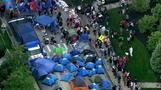 Protesters camp out, hit the street for $15 wage