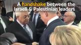 Palestinian and Israeli leaders shake hands at Peres funeral
