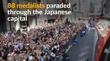 Japan's Olympic heroes cheered on by huge crowds