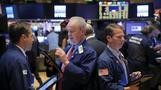 Wall Street dips with financials, weak China data