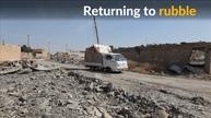 Iraqi village residents return to rubble