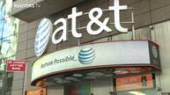 AT&T, Time Warner take merger mania to new heights
