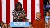 "Clinton absolutely ready, ""happens to be a woman,"" says Michelle Obama"