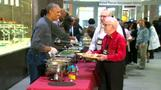 Service with a smile as Obama offers Thanksgiving fare to veterans