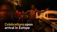 Migrants cheer as they reach Europe