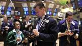 Wall Street closes mixed
