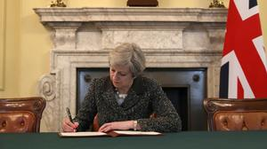 UK prime minister signs Brexit letter to EU
