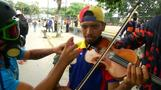 Violence flares in Venezuela, protesting violinist injured