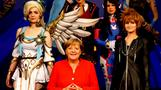 Merkel kicks off Gamescom, tries 'Farming Simulator'