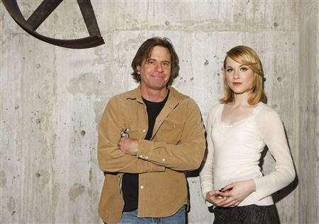 Mike Cahill (L), director of ''King of California'' and actress Evan Rachel Wood pose for a portrait during the Sundance Film Festival in Park City, Utah, January 24, 2007. REUTERS/Lucas Jackson