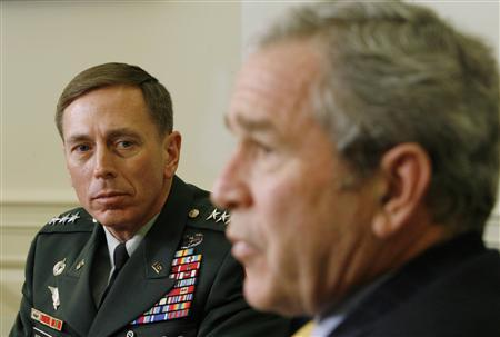 U.S. Lieutenant General David Petraeus (L) watches during his meeting with President Bush in the Oval Office of the White House, January 26, 2007. REUTERS/Kevin Lamarque