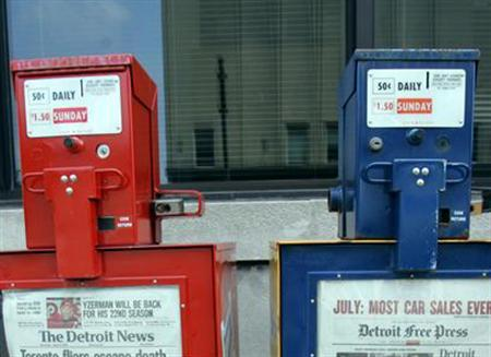 Newspaper boxes in downtown Detroit in a file photo. More teachers are using national and international online news sites in the classroom, leaving behind newspapers that fail to grasp the Internet's importance in trying to reach students, a study found. REUTERS/Rebecca Cook
