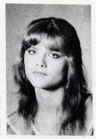 Celebrity Anna Nicole Smith's photo is seen in a 1985 Mexia High School year book under the name, Nikki Hart, in Mexia, Texas February 9, 2007. Educators at the High School say Smith went by the name Nikki Hart during her brief tenure there. Smith was found dead Thursday in a hotel room. REUTERS/Jessica Rinaldi