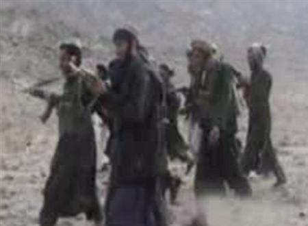 An undated video grab shows a group of Taliban at an undisclosed location in Afghanistan. At least 700 Taliban fighters have crossed from Pakistan into Afghanistan to destroy a key dam, a major source of electricity, a provincial governor said on Monday. REUTERS/via RVN