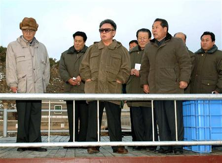 North Korean leader Kim Jong-il (C) visits a fish farm in Hamgyongpukdo in North Korea in an undated photo released by the Korea Central News Agency on February 8, 2007. REUTERS/Korea News Service