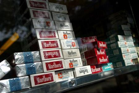 Marlboro and other cigarettes are seen inside a supermarket in New York in a 2004 file photo. A divided Supreme Court set aside on Tuesday a $79.5 million punitive damages award won by a longtime smoker's widow against Altria Group Inc.'s Philip Morris unit, which owns the Marlboro brand. REUTERS/Shannon Stapleton