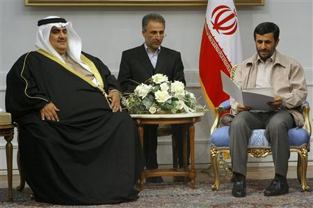 Iran's President Mahmoud Ahmadinejad (R) reads a message from the King of Bahrain during his meeting with Bahrain's Foreign Minister Khalid bin Ahmad al-Khalifa in Tehran February 24, 2007. Ahmadinejad said on Sunday the country had ''no reverse gear'' on its way to mastering the technology to make nuclear fuel, Iran's student news agency ISNA reported. REUTERS/FARS NEWS